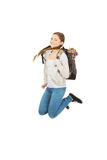 Teen woman jumping with backpack. Royalty Free Stock Photos