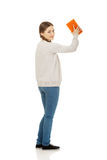 Teen woman with kitchen sponge. Royalty Free Stock Photography