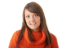 Teen woman in orange sweater Royalty Free Stock Images