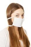 Teen woman with protective mask. Royalty Free Stock Photos