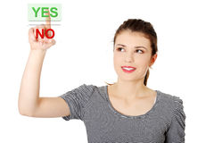 Teen woman pushing yes button Stock Images