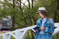 Teen woman read book outside Stock Photo