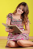 Teen woman reading a book Stock Images