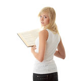 Teen woman reading book Stock Photography