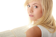 Teen woman reading book Stock Images