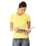 Teen woman reading book Royalty Free Stock Images