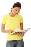 Teen woman reading book Stock Image