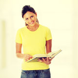 Teen woman reading book Royalty Free Stock Photo