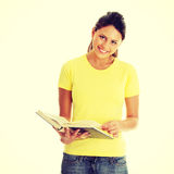 Teen woman reading book Royalty Free Stock Image