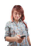 Teen woman reading sms on mobile phone Stock Photography