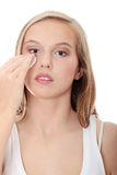 Teen woman removing makeup Stock Photo