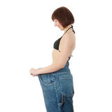 Teen woman showing how much weight she lost Stock Images