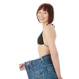 Teen woman showing how much weight she lost royalty free stock images
