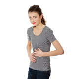 Teen woman with stomach issues Royalty Free Stock Image