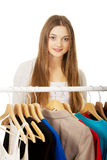 Teen woman thinking what to put on. Royalty Free Stock Photos