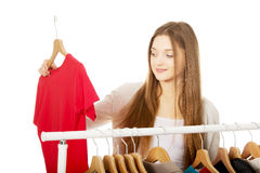 Teen woman thinking what to put on. Royalty Free Stock Images