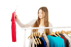 Teen woman thinking what to put on. Royalty Free Stock Photography