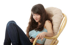Teen woman watching TV Royalty Free Stock Photography