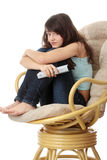 Teen woman watching TV Royalty Free Stock Images