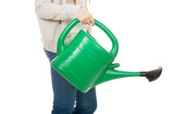 Teen woman with watering can. Stock Photography
