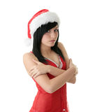 Teen woman wearing Santa hat. Beautiful young woman wearing Santa hat at Christmas isolated against white background Stock Photos