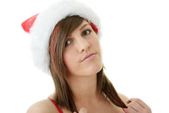 Teen woman wearing Santa hat Stock Images