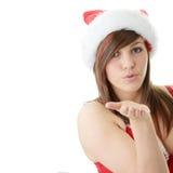 Teen woman wearing Santa hat. Beautiful young woman wearing Santa hat at Christmas isolated against white background Royalty Free Stock Photo