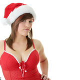 Teen woman wearing Santa hat Stock Image