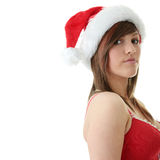 Teen woman wearing Santa hat. Beautiful young woman wearing Santa hat at Christmas isolated against white background Royalty Free Stock Photos
