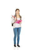 Teen woman writing with huge pencil. Stock Photo