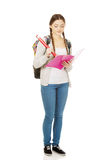 Teen woman writing with huge pencil. Stock Image