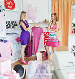 Teen women choosing clothes together Stock Image