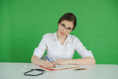 Teen writing in journal Stock Image