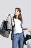 Teen (young girl) shopping with bags Stock Image