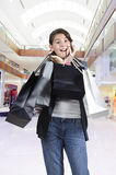 Teen (young girl) shopping with bags Royalty Free Stock Photos