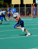 Teen Youth Football Player with Ball. Teen Youth Football Player running with ball on field during game Royalty Free Stock Photo