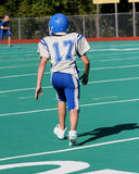 Teen Youth Football Player Running Stock Photos