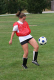 Teen Youth Soccer  Action 21. Teen Youth Soccer Player bouncing ball off knee during practice Royalty Free Stock Images