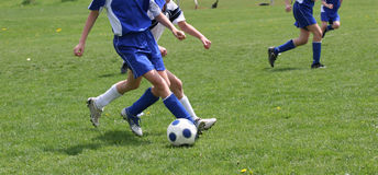 Teen Youth Soccer Action. Teen Youth Girls chasing ball down soccer field Royalty Free Stock Photos