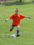 Teen Youth Soccer Goalie Action. Teen Youth Teen Soccer Goalie ready to kick ball Royalty Free Stock Photography
