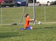 Teen Youth Soccer Goalie Action. Teen Youth Teen Soccer Goalie ready to catch ball Royalty Free Stock Photos