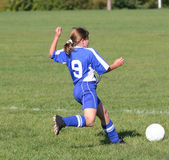 Teen Youth Soccer Kicking Ball. Teen Youth Soccer Player kicking ball during game Stock Images