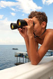 A teenadger looking through binoculars Stock Photos