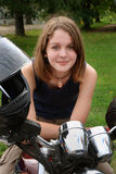 Teenage 01. Teenage girl on the motorcycle Royalty Free Stock Images
