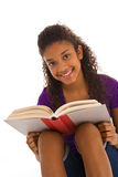 Teenage African ethnicity girl reading a book Stock Photo