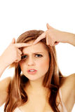 Teenage angry woman poping pimple Royalty Free Stock Photography