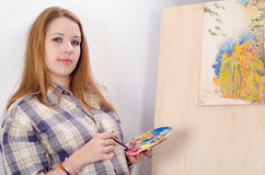 Teenage artist painting landscape Royalty Free Stock Image