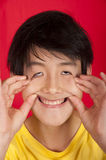 Teenage Asian boy making silly face Stock Photo