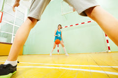 Teenage Asian girl dribbling basketball on court royalty free stock photography