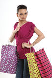 Teenage asian girl with shopping bags. Modern teenage asian girl with shopping bags Royalty Free Stock Photography
